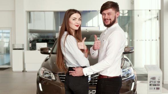 Thumbnail for Couple Comes Closer To the Black Car at the Dealership