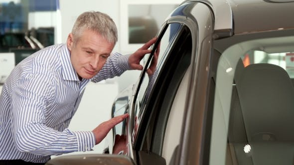 Thumbnail for Mature Man Touches the Car Door at the Dealeship