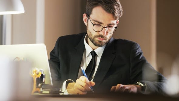 Thumbnail for Young Businessman Writing and Thinking Deeply