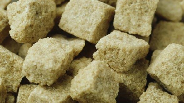 Thumbnail for Unraffinierter brauner Zucker. Würfel rotieren