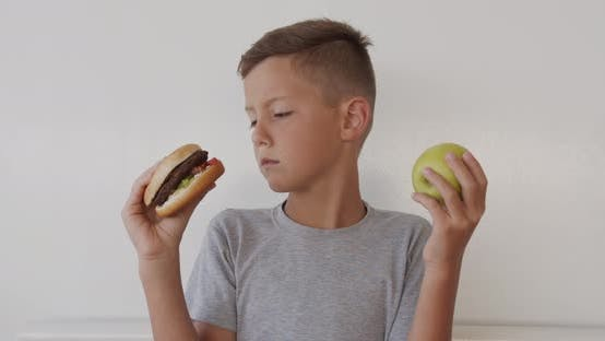 Thumbnail for Boy Choosing Healthy or Unhealthy Food, Boy Making a Choice Between Apple and Burger