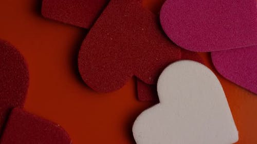 Rotating stock footage shot of Valentines decorations and candies - VALENTINES 0091