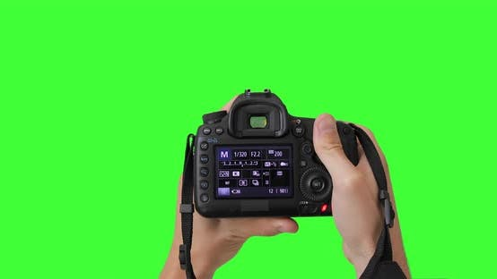 Thumbnail for Man photographer is taking photos with professional digital camera. Keyed chroma key