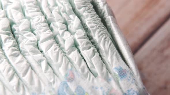 Stack of Baby Diaper on Table