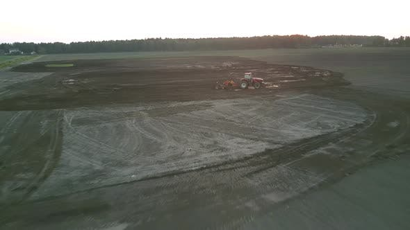 Thumbnail for Cultivator Works in Field with Plough at Farmland Aerial