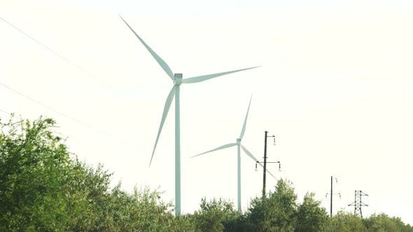 Windmills Spinning on Clear Sky Background