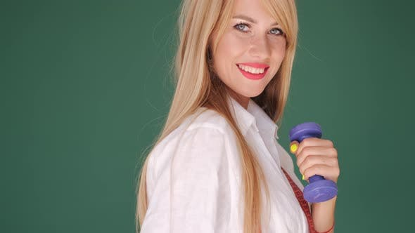 Thumbnail for Beautiful Blonde with Dumbbells on Green Background