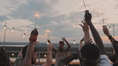 People with Sparklers Partying on Rooftop