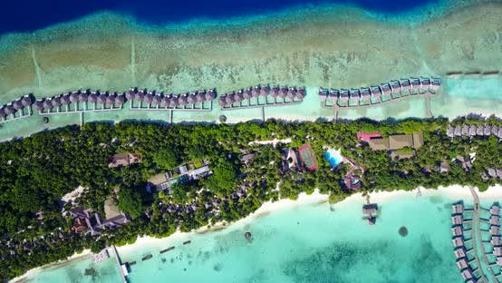 Thumbnail for Tropical birds eye travel shot of a sunshine white sandy paradise beach and blue sea background in v