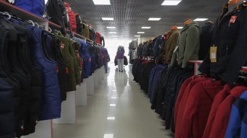 Clothes hanging neatly on hangers.