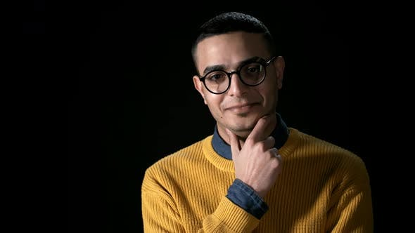 Thumbnail for Young Smiling Arab Man on Black Background