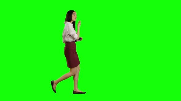 Thumbnail for Asian Girl Listening To Music in White Headphones. Green Screen