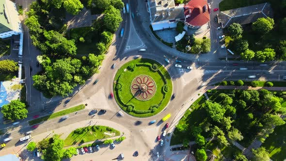 Thumbnail for Aerial View Timelapse of Roundabout Road with Circular Cars in Small European City at Sunny Summer