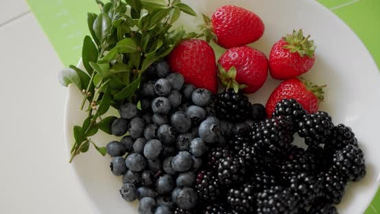 Strawberry, Blackberry and Fresh Mint Leaves on the Plate. Fresh Organic Healthy Fruits. Top View