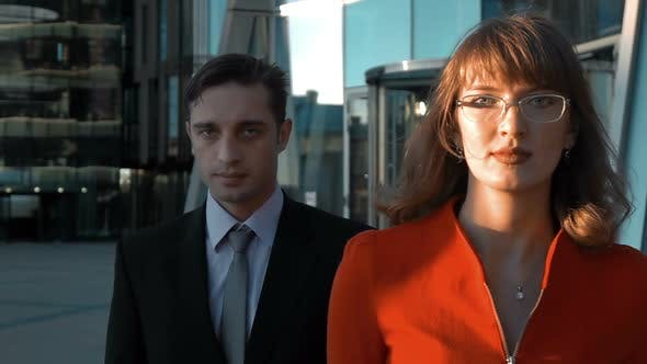 Thumbnail for Two Serious Business People Walking
