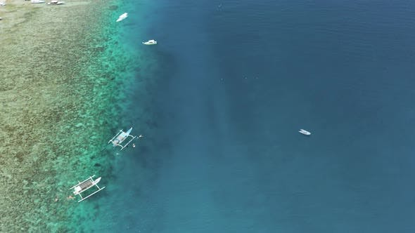 Thumbnail for Aerial view of tourist boats and snorkelers on a coral reef