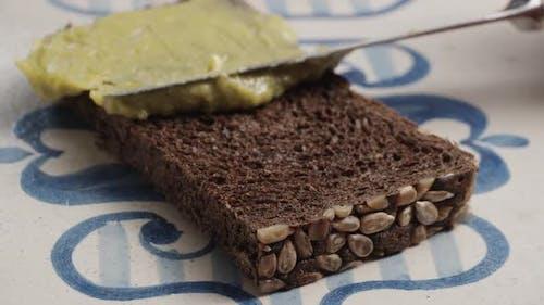 Avocado Spread on the Piece of Dark Bread