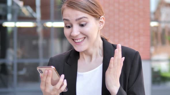 Cover Image for Wow, Young Businesswoman Surprised on Smartphone