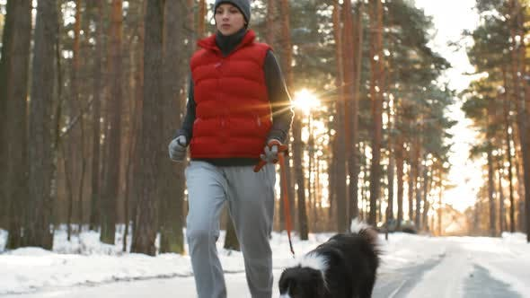 Thumbnail for Woman Training with Dog in Winter Woods