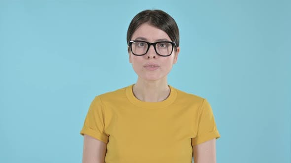 Young Woman Feeling Shocked and Annoyed on Purple Background
