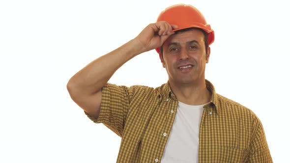 Thumbnail for Handsome Mature Engineer Wearing Hardhat Smiling Confidently