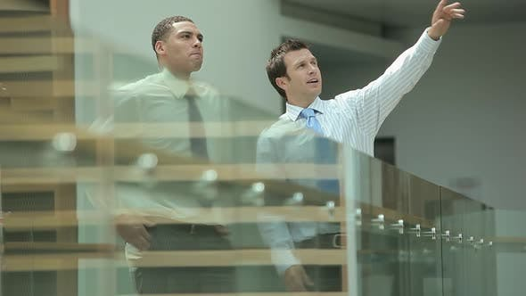 Thumbnail for Businessmen looking at office building