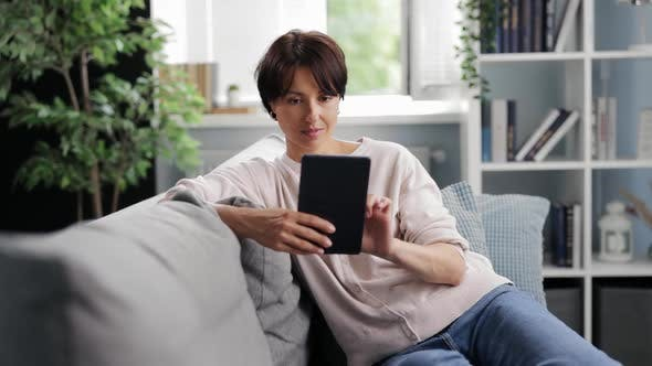 Woman Using Tablet at Home