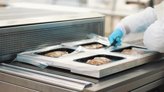 Meat Production, the Process of Packaging Pork Meat Products in Plastic Packaging.