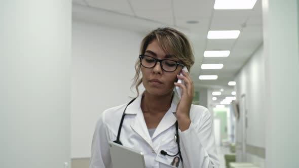 Female Practitioner Speaking on Phone