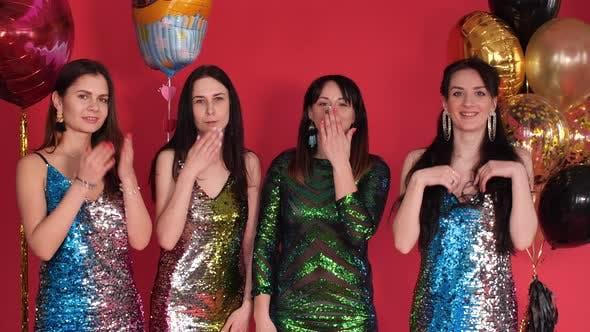 Thumbnail for Trendy Ladies in Sparkling Dresses Blowing Air Kisses at Camera
