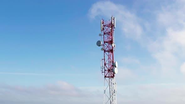 Aerial Radio Communication Base Station on a Blue Sky Background
