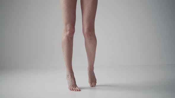 Thumbnail for Female Legs Close Up. Girl Spinning on Tiptoes Barefoot