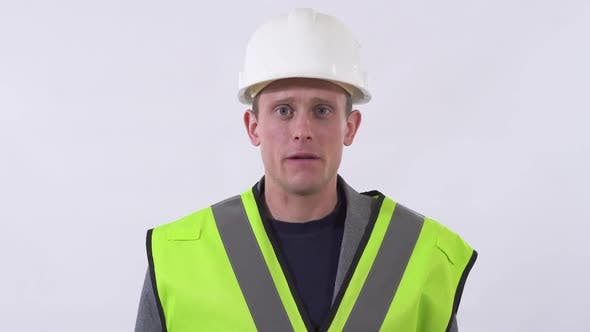 Thumbnail for Portrait of Builder in Uniform Speaking and Looking in the Camera