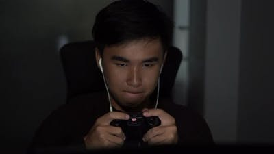young man using joystick to playing games