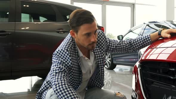 Thumbnail for An Attentive Customer Is Studying the Bumper of His New Car