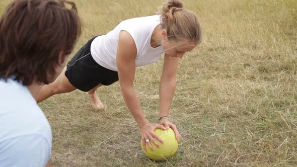Thumbnail for Female being coached by personal trainer in park