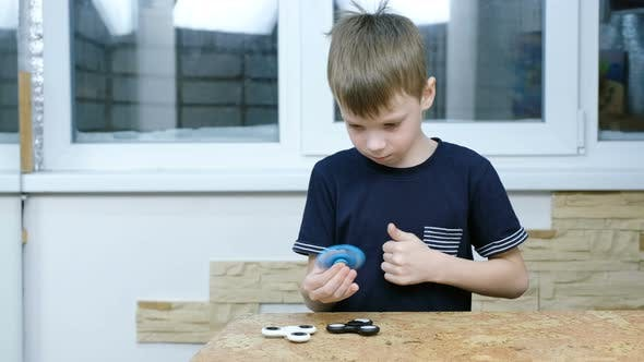 Thumbnail for Little Child Playing with Modern Popular Hand Toy - Spinner Spinner Hypnotizing Boy