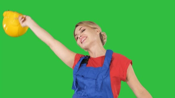 Cover Image for Tradeswoman dancing with a pencil on a Green Screen, Chroma Key.