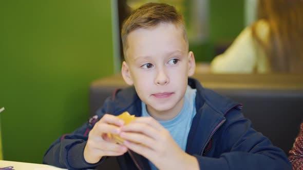 Thumbnail for Young Teenager Eating Tasty Hamburger