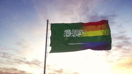 Waving National Flag of Saudi Arabia and LGBT Rainbow Flag Background