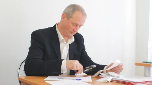 Thumbnail for Adult Businessman Doing Accounting