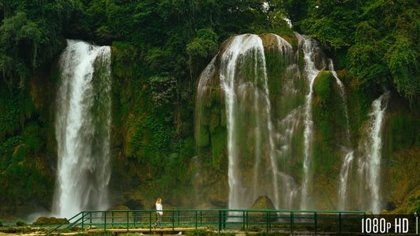 Thumbnail for Woman Walking in Front of Bao Gioc Waterfall in Cao Bang, Vietnam
