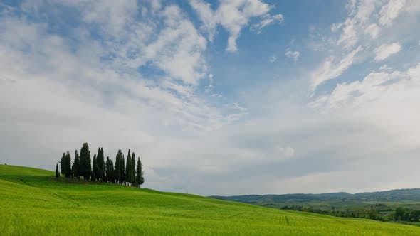 Time Lapse of the clouds over the beautiful rolling hills of Tuscany Italy.
