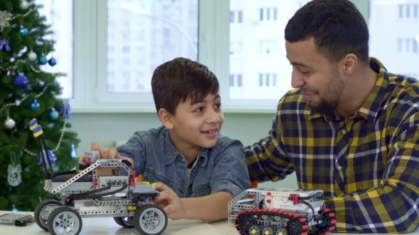 Cover Image for Father and Son Play with Toy SUV