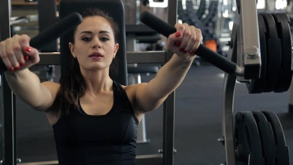 Thumbnail for In the Gym Beautiful Woman Performs a Bench Press From the Chest.