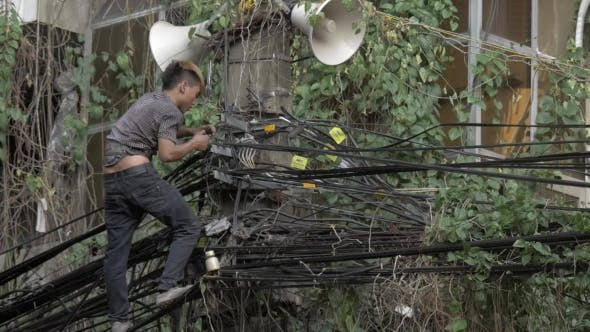 Young Electrician at Work. Hanoi, Vietnam