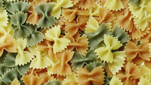 Thumbnail for Rotate the Pasta of Different Colors in the Form of a Bow