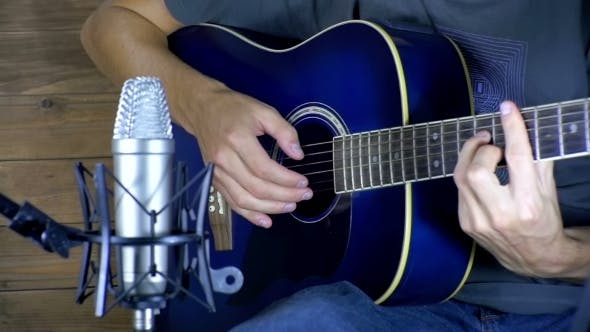 Thumbnail for Musician Recording Acoustic Guitar in Microphone on the Home Studio