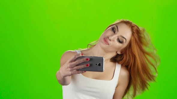 Thumbnail for On the Smartphone Camera Redhead Girl Doing Selfie. Green Screen
