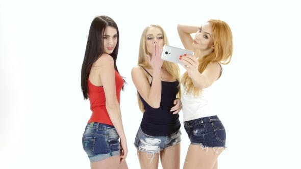 Thumbnail for Three Girls of Model Appearance Make Selfie To Camera Smartphone